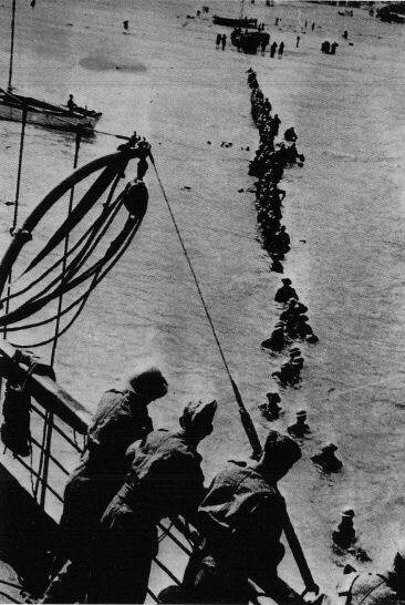 British troops wading off the beach to rescue.  While this is one of the iconic images of the war, the beach accounted for about 1/3 of the rescues at Dunkirk; most were picked up from the docks and the harbor mole.