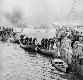British troops clamber across boats to get to a larger boat